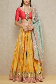 Abhinav Mishra fuses colors that make a beautiful color block attire featuring a yellow mirror embellished lehenga paired with a pink choli and a light blue dupatta. Style the look with a statement long necklace and chandbalis. Dress Indian Style, Indian Dresses, Indian Outfits, Funky Dresses, Stylish Dresses, Pretty Dresses, Party Wear Lehenga, Lehenga Wedding, Indian Lehenga