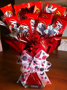 4th day of christmas..4 candy bars. (a candy bar bouquet with his favs - not kit kat - in a small vase and a reason I love him tied to each one)