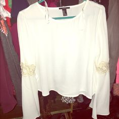 Cream bell sleeved crop top with crochet details No longer has the tags but never worn. Size m crop top from forever 21 with bell sleeves and crochet detail on the arms Forever 21 Tops Blouses