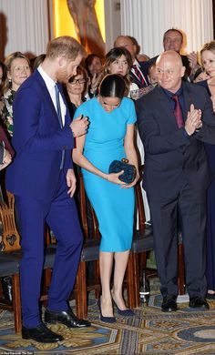 The Duchess of Sussex stepped out in a vivid turquoise Victoria Beckham dress as she began her final run of royal duties (the royal couple are pictured sitting next to Ross Kemp) Meghan Markle Photos, Meghan Markle Style, Prince Harry And Megan, Harry And Meghan, Ross Kemp, Sussex, Prinz Harry, Princess Meghan, Royal Life