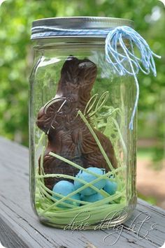 Easter bunny in a jar. What a cute gift idea! chocolate bunny, edible grass, robin's eggs malt balls, mason jar. (good way to package chocolate bunny so you can include it in the egg hunt.)