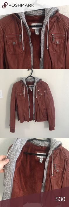 Leather jacket Selling my Burgundy leather hooded Jacket, super warm and cute. Perfect Condition! Offers accepted💕 Happy Poshing! Buckle Jackets & Coats