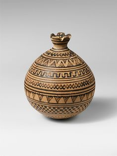 Terracotta vase in the form of a pomegranate    Period:      Geometric  Date:      8th century B.C.  Culture:      Greek, Attic  Medium:      Terracotta  Dimensions:      H. 4 in. (10.2 cm) diameter 3 1/4 in. (8.3 cm)  Classification:      Vases