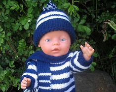 The Evelyn Knitting Pattern is for Summer outfits for Baby Dolls - Such a sweet pattern and easy to knit. Looks great made in cotton yarns. An original design by Miss Meggy Designs.  A PDF downloadable pattern, not supplies or a finished item. Available in English only. Included in this pattern are instructions to make summer time outfits including a sleeveless top, bloomers, dropwaist dress, panties and scarf hat. Suggested yarn is a cotton or cotton blend 8 ply / double knitting yarn, ...
