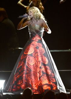 "Carrie Underwood literally lit up the stage with her dress, which doubled as a projection screen, during a stripped-down performance of ""Blown Away"" at the 55th GRAMMY Awards in 2013"