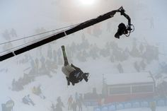 ALONGSIDE: A jib followed U.S. skier Kyle Smaine in the men's half pipe race at the Snowboard & Freestyle World Cup Super finals near Granada, Spain, Monday. (Javier Soriano/AFP/Getty Images)