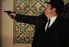 Neverland. Thursday holds the gun