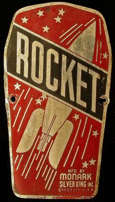Rocket. Metal Advertising Plate looks like it is from the front of a Bicycle.