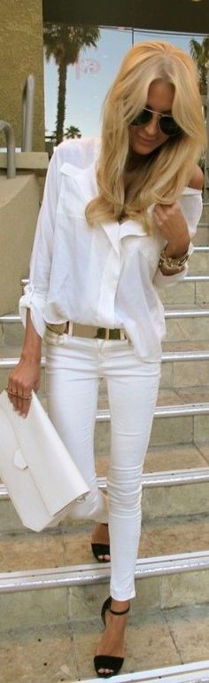 Pair your white jeans with a white blouse or tee for a bold fall look. Bring in some color with a darker belt or a strappy black shoe.