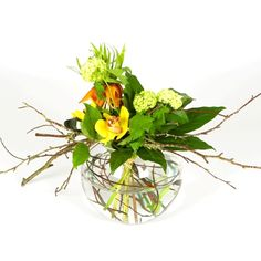 Beautiful contemporary design flower bouquets in fish bowl vases.