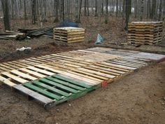 Pallet patio foundation - Mason blocks, gravel, and leveling sand to make footings. Place the pallets together with some deck screws and some 2x4's.