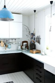 White upper cabinets and bottom black cabinets.