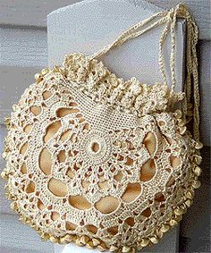 Use a shiny silk thread in light gold for this beautiful heirloom-quality Silk Lace Crochet Bag Pattern. Small beads also compliment the design of this crochet lace pattern. The delicate look and vintage flair make this pattern a standout.