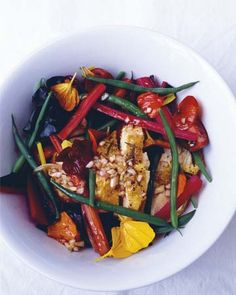 Nigel Slater offers a simple but elegant salad recipe that's topped with grilled or roasted chicken breast. Cooking the green beans just briefly allows them to retain a nice crunch, and an easy shallot vinaigrette completes this no-frills, no-sweat dish. Feel free to use spinach in place of...
