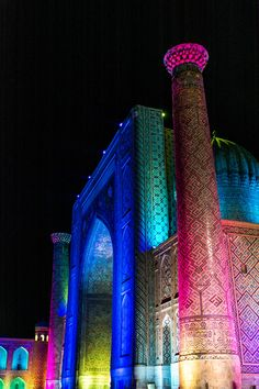 A rainbow version of the Registan in Samarkand, Uzbekistan, lit up during its daily light show at 9:30 P.M.
