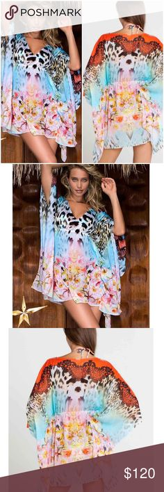 Luli Fama: 'La Isla Bonita' Caftan dress - One Sz Too amazing for words to describe, stunning printed La Isla Bonita Caftan dress features an engineered print. Elasticized high bodice allows for easy fit for all sizes and flowy sleeves and hemline are amazling on. Deep V neckline is flattering on and easy to wear. Available in One Size only. 100% Nylon Luli Fama Swim Coverups