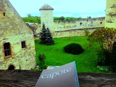 Part of the Câlnic Medieval Fortress and a book.  #book #medievalfortress #bookstagramer #bookobsessed #booklover #tripslover #tripstagram #bookworm #visitromania #visittransylvania by anareads
