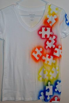 How awesome is this?! Just spray paint around puzzle pieces and you get an autism awareness shirt