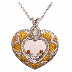 Chopard Fancy Diamond Gold Heart Pendant | From a unique collection of vintage drop necklaces at http://www.1stdibs.com/jewelry/necklaces/drop-necklaces/ 34.9k USD