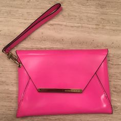 BCBG Wristlet | Hot Pink BCBG Wristlet | Hot Pink | button closure | never been used | small mark on top from storage | tags attached | BCBGMaxAzria Bags Clutches & Wristlets