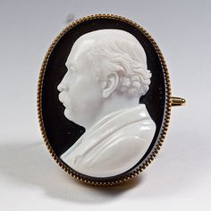 Amazing Hardstone Portrait Cameo by Luigi Rosi in Gold Brooch Frame. Wonderful example of high carved portrait of a male in profile by Luigi Rosi. The detail is truly precise, set in a gold brooch frame. Signed on front of gem. Agate and gold, Italy, circa 1870. H: 2-1/2″ L: 1-3/8″