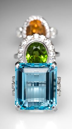 The House of Beccaria created these stunning engagement rings in bold colors with diamond accents.
