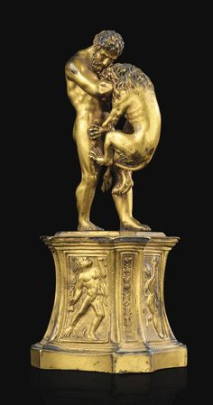 AN ITALIAN 17TH CENTURY GILT BRONZE GROUP WITH HERCULES AND THE NEMEAN LION; ON A GILT BRONZE BASE. Haut. (totale) 17 cm; height (overall) 6 2/3 in. -Sotheby's-