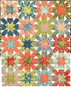 Bursting with warm and cool colors, this Starburst Cross Block Quilt is a beauty.