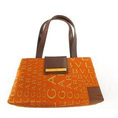 New 1990's Bvlgari Burnt Orange Logo Print Handbag | From a collection of rare vintage top handle bags at https://www.1stdibs.com/fashion/handbags-purses-bags/top-handle-bags/
