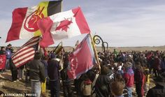 Gathering: A crowd gathers to mark the 30th anniversary of the American Indian Movement standoff near the gravesite at Wounded Knee, S.D