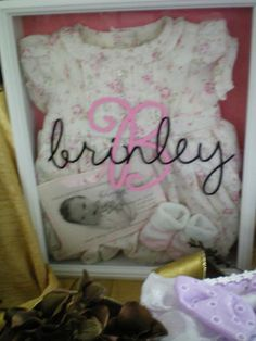 Take a standard shadow box from Hobby Lobby or Michael's. Add your keepsakes. Create your baby's name thru Uppercase Living My Design Suite. Select the font, size & color you prefer! Kellies387107.uppercaseliving.net