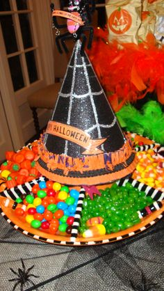 Awesome Halloween party idea, pop a witches hat on your candy divider dish #Halloween #Crafts and #Ideas