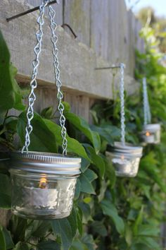A great garden lighting idea: tea candles in jelly jars hung from your fence!