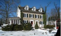 Bucks County PA stone house. Note: white windows, green shutters, red door, black roof, dormers....:)