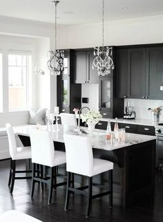 6. Lighting A black kitchen can have various different feels to it depending on the lighting you choose. If you want a kitchen for the modernist connoisseur, go with white lights that hang in small, thin bulbs from the ceiling. If you want to go for something a little more traditional, lots of natural lighting and a chandelier (yes!) can be the trick.