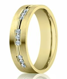 Channel set diamonds in rich 14K yellow gold are instantly eye-catching in this men's designer diamond wedding ring. $879.95