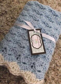 Hand Crocheted Baby Blanket - Lovey Size Blanket - Sky Blue with Oatmeal Trim - Boy or Girl. $20.99, via Etsy.