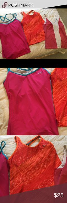 Lot of 3 tank tops. Fila, Nike, Under armor 3 large athletic, tennis tank tops with built in shelf bras. In good shape. Have been worn but no stains. Smoke free home. Nike Tops Tank Tops