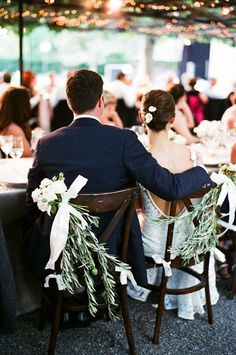 Gorgeous rose and olive branch chair decorations | @giacanali | Brides.com