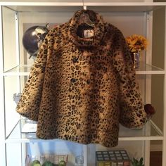 Free People Cheetah faux fur cape jacket Love this cape jacket for fall! Cowl neck and flare fit.  All proceeds of my Poshmark closet will be donated to my local animal shelter  Free People Jackets & Coats