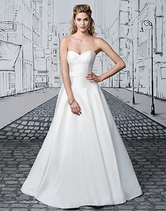 Justin Alexander style 8898. Available at Low's Bridal.