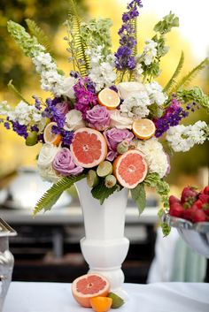 The colors in this arrangement is just so sweet! The citrus in it is kind of spunky too!