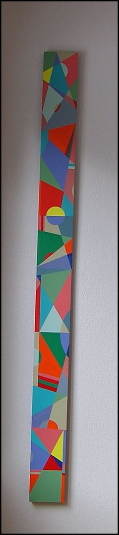 An original oil on board by D. Mattingly. Jenna had this piece specifically done for her by the artist of Indianapolis. The colorful geometric design has hints of Frank Lloyd Wright. Being a mathematician, the geometry caught Jenna's eye. This is her second Mattingly piece. He did a series of totems for an art opening. This one never appeared in his show because it was privately commissioned by Jenna.