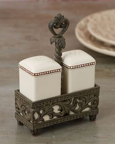 GG Collection Salt & Pepper Set from Horchow.com.  Square salt & pepper in their own mini tray with center handle.