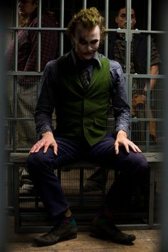 This shot does a good job of showing that even though the Joker is in prison, he has no problem with it, and is enjoying himself.