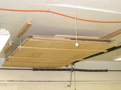 Plywood storage - Build walls up on both sides and form a storage place above your head for plywood.....