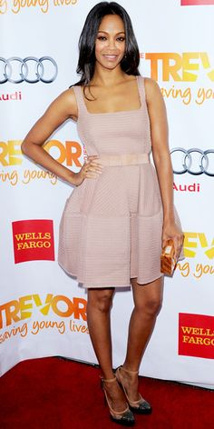 Zoe Saldana wearing a bowed Lanvin cocktail dress styled with the label's wood box clutch and sparkling cap-toes, gold Melinda Maria jewelry and Dana Rebecca Designs diamonds.