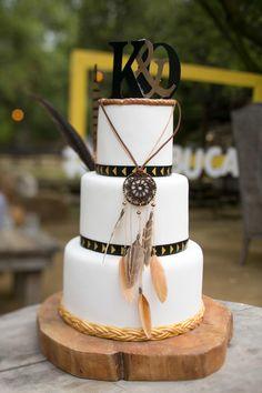 Boho wedding cake, white fondant, braided gold trim, feathers, dreamcatcher // Michael Segal Photography