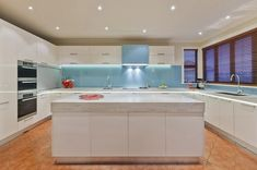 marble modern white #kitchen with aqua #glass #splashback