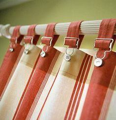 Great for a boy's room! Creative Do-It-Yourself Window Treatment, instead of conventional tabs, use overall buckles to hang simple panels on a drapery rod. Look for the buckles at a fabrics store.